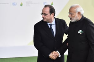 French president Francois Hollande, left, welcomes Indian prime minister Narendra Modi on his arrival at COP21 talks on Monday