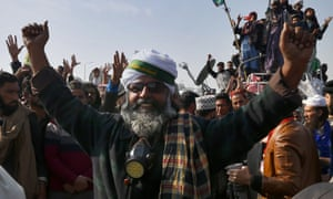Supporters of the hardline Tehreek-e-Labbaik party celebrate after Zahid Hamid's resignation, during a protest in Islamabad.