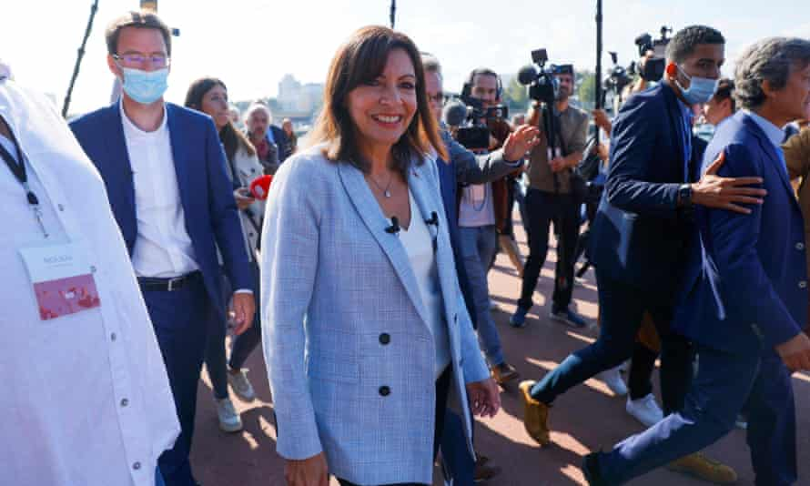 The mayor of Paris, Anne Hidalgo, surrounded by journalists  in Rouen, western France