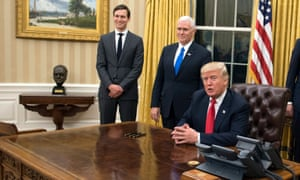 A replica of Churchill's face sits on a table near Donald Trump in the Oval Office.