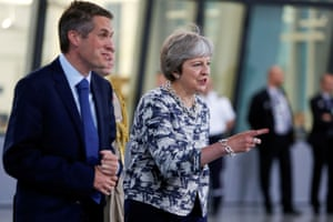 Gavin Williamson and Theresa May during a Nato summit in Brussels, Belgium.
