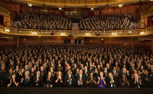Audience applauding in a theatre