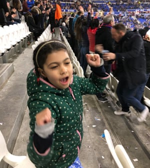 Ella, the writer's daughter, cheering at the match in Lyon, France