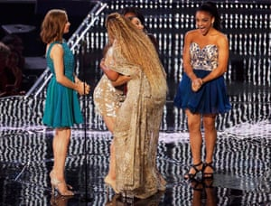 Beyoncé accepts the female video of the year award from US Olympic gymnasts Madison Kocian, Aly Raisman, Simone Biles and Laurie Hernandez.
