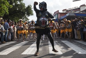 Thousands of spectators line the streets cheering the dancers as they pass