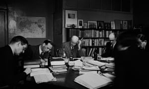 Geoffrey Faber, centre, and TS Eliot, left, at a Faber & Faber directors meeting in 1944 to discuss how best to use the paper ration.
