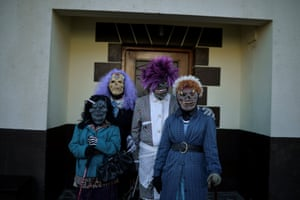 Masked revellers stand outside a house during carnival celebrations in Ituren
