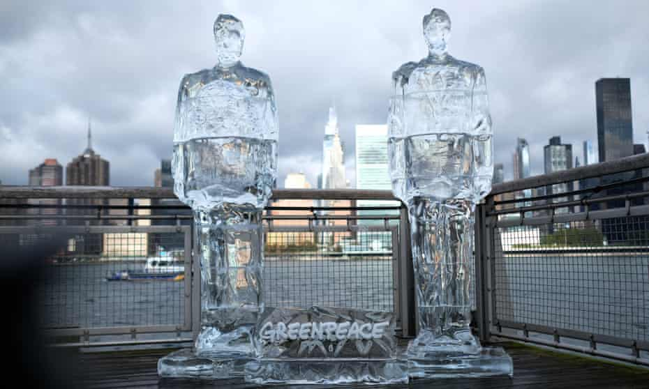 Donald Trump and Jair Bolsonaro 'Meltdown' ice sculptures in New York City. The sculptures were created to expose their absence at the UN summit on 30 September.