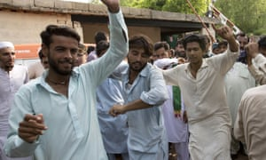 Supporters of Imran Khan dance in celebration outside his home in Islamabad on Thursday.