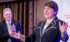 Peter Robinson watches on as Arlene Foster reacts