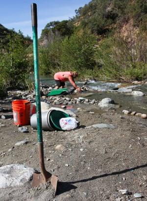 Robert Ferguson in the river, prospecting for gold.