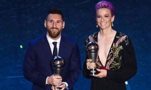 Lionel Messi and Megan Rapinoe pose with their trophies at Fifa's The Best awards earlier this year