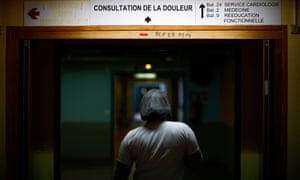 A nurse walks at the Robert Ballanger hospital in Aulnay-sous-Bois near Paris.