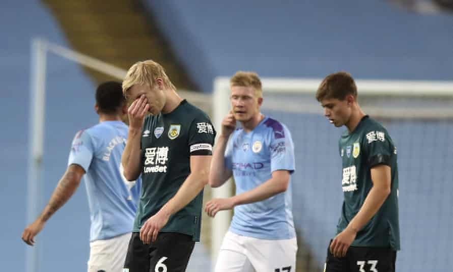 Ben Mee reacts as he leaves the field after a shameful night for Burnley.