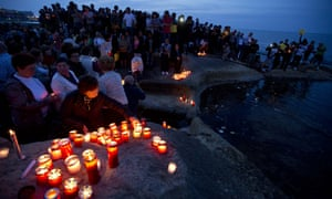 A vigil in the district of Sliema for those killed when a smuggler's boat crammed with hundreds of people overturned in April 2015.