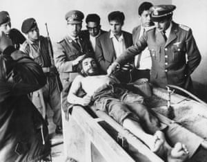 Che Guevara is put on display in the laundry house of the hospital in Vallegrande, Bolivia, the day after his execution.
