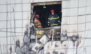Russian emergency service staff work at the site of the fire