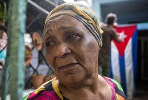 Rafaela Vargas mourns the death of former President Fidel Castro at the entrance of her home in the Vedado neighborhood of Havana