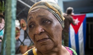 Outside her home in Havana, Rafaela Vargas mourns the death of Fidel Castro.