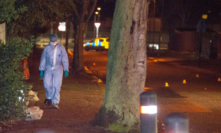A forensic investigator gathers evidence on Courtland Avenue near Scratchwood Park. Police have urged young people with information about violence or knife crime to visit www.fearless.org.