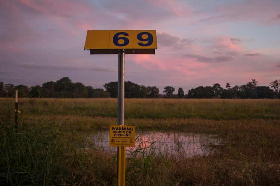 A warning sign marking the location of the Bayou Bridge Pipeline stands across the road from the L'eau Est La Vie Camp. Water often pools and gathers over locations where the pipeline has been buried in the wetlands of southern Louisiana.