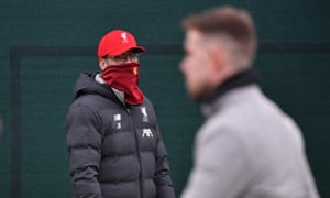 Jürgen Klopp covers his face during a Liverpool training session in March.