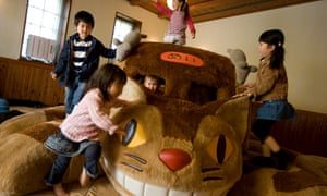 Children play on Cat Bus – a recreation of a character from the animated film My Neighbour Totoro inside Ghibli Museum, Tokyo