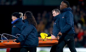 Watford's Gerard Deulofeu is stretchered off the pitch.