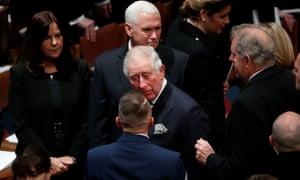 Prince Charles walks past Pence.