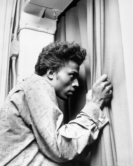Musician Little Richard peers out of a curtain circa 1957.