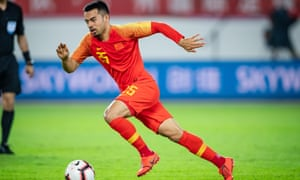Nico Yennaris, who was playing for Brentford until January, in action for China eatlier this month and as he is now known – Li Ke.