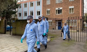Police officers conduct a search of a bail hostel in south London after the Streatham attack