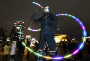 A young man dressed as a ghost takes part in a party to celebrate Halloween in Minsk, Belarus