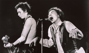 Sid Vicious, left, and Johnny Rotten of the Sex Pistols perform at the Winterland auditorium on 15 January 1978.
