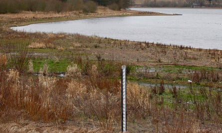 A water depth marker stands on dry ground at a reservoir in central England, in February 2012.