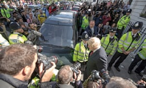 Boris Johnson leaves his home in Islington, north London, to shouts of 'scum' and 'traitor'.