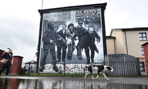 A mural in Derry depicting the famous image of Jackie Duddy being carried away after being shot.