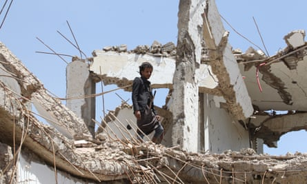 A man stands amongst debris of a destroyed house allegedly hit by a Saudi-led airstrike in Sana'a, Yemen