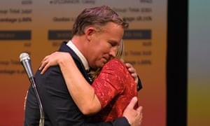 Tasmania's premier Will Hodgman embraces his wife Nicola after giving his victory speech in Hobart.