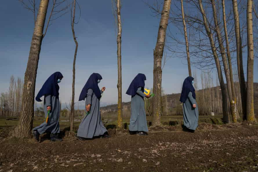 Girls walk towards school after play