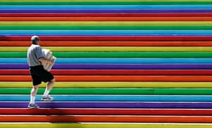 A city hall employee walks up a flight of rainbow stairs in Vancouver in 2005 as part of week-long celebrations marking Gay Pride Week in the city