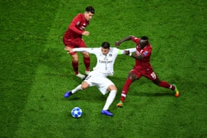 Thiago Silva of PSG is challenged by Sadio Mane of Liverpool.