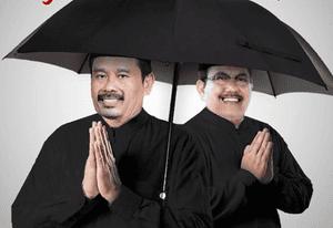 Nurhadi and Aldo take shelter from the rain.
