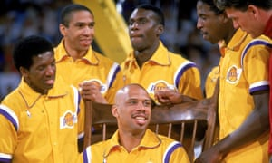 Kareem Abdul-Jabbar is surrounded by his team-mates during his retirement ceremony in 1989, after a 20-year NBA career
