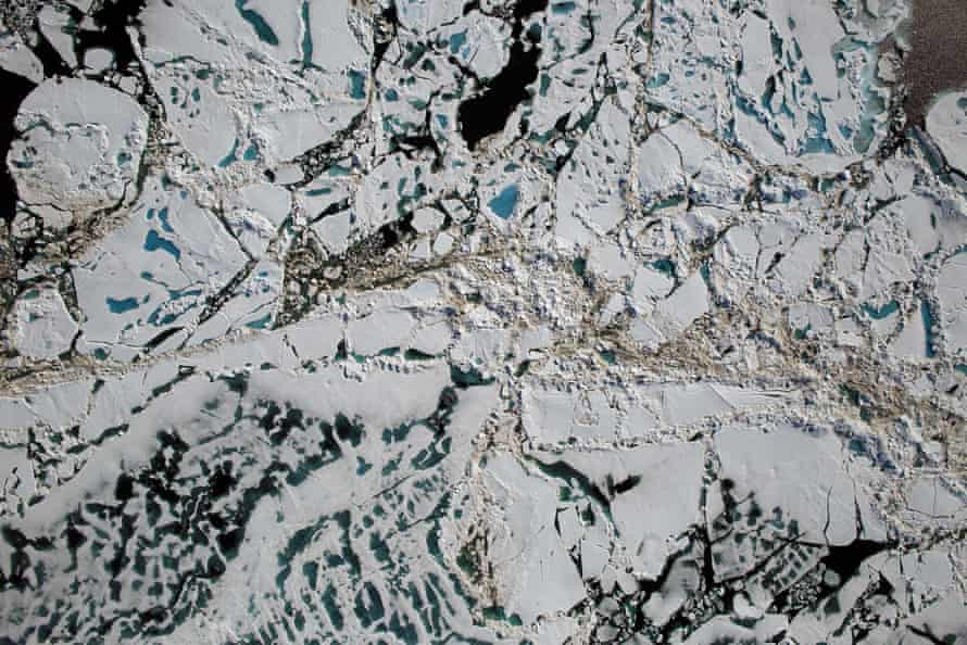 An aerial view of melt pools on Arctic ice