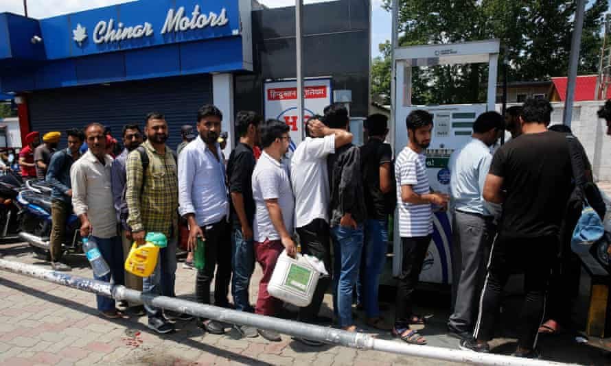 Kashmiri residents queue outside petrol stations after the alert.