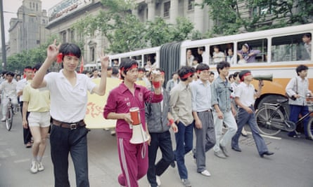 Students march down a Shanghai main street on 10 June 1989