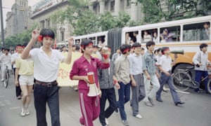 College students march down a Shanghai main street on 10 June 1989