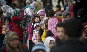 Syrians at refugee camp near the Bab al-Salam border crossing on the Turkish-Syrian border.