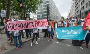 Groups of people on the street with banners at Pip protest